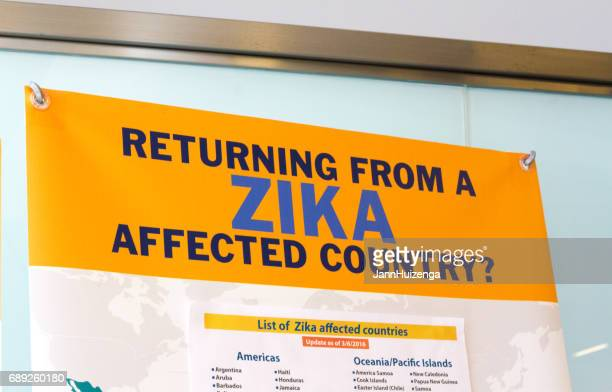 valletta, malta: warning sign for zika virus at ferryboat station - zika virus stock pictures, royalty-free photos & images