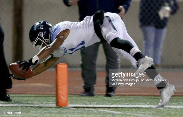 Valley Christian's Isaiah McElvane scores a touchdown against St Francis in the first quarter of their Central Coast Section Open Division II...