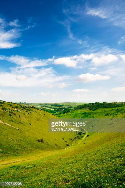 valley hills and blue sky - valley stock pictures, royalty-free photos & images