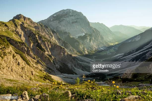 valley in the karwendel mountain range - karwendel mountains stock pictures, royalty-free photos & images