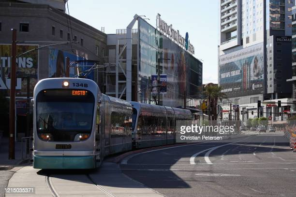 Valley Metro Rail train drives through downtown on March 26, 2020 in Phoenix, Arizona. Despite fears from the Coronavirus pandemic Valley Metro...