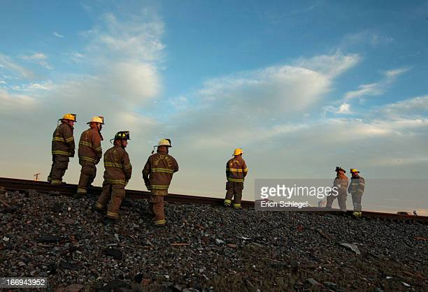 Valley Mills Fire Department personnel view the railroad tracks near to the fertilizer plant that exploded yesterday afternoon on April 18 2013 in...