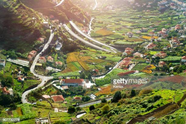 valley of camara de lobos in madeira, portugal. buildings, gardens and the highway vr1 - madeira island stock photos and pictures
