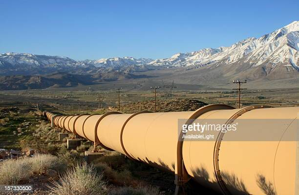 valley pipeline with mountain range - pipeline stock pictures, royalty-free photos & images
