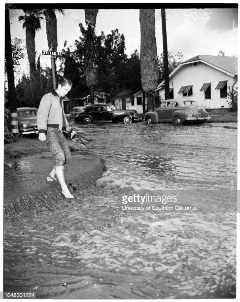 Valley rain Tyrone Avenue and Sylvan Street Van Nuys 14 November 1952 Mrs Agnes SnyderWayne WilsonCaption slip reads 'Photographer Glickman Date...