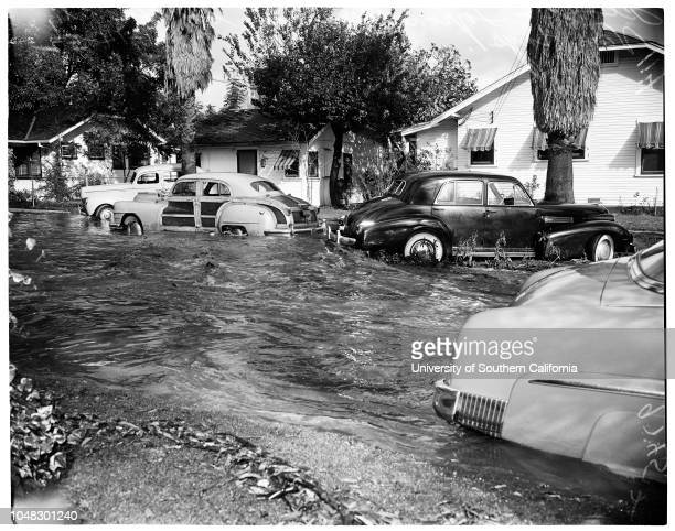 Valley rain Tyrone Avenue and Sylvan Street Van Nuys, 14 November 1952. Mrs Agnes Snyder;Wayne Wilson.;Caption slip reads: 'Photographer: Glickman....