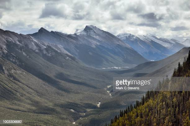 a valley view with rundle peaks. - sulphur mountain stock pictures, royalty-free photos & images