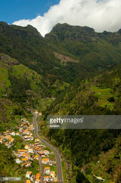 A valley with houses and terraced fields in the interior of the Portuguese island of Madeira