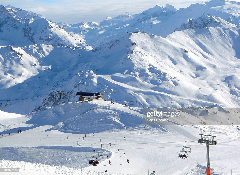 Valley with ski lifts and ski piste : Stock Photo