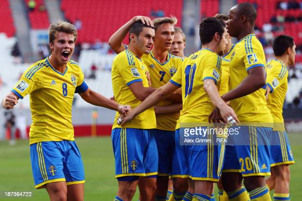 Valmir Berisha of Sweden celebrates his team's first goal with team mates during the FIFA U17 World Cup UAE 2013 3rd place playoff match between...