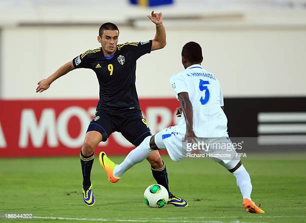 Valmir Berisha of Sweden is tackled by Anoal Hernandez of Honduras during the FIFA U17 World Cup UAE 2013 Quarter Final match between Honduras and...