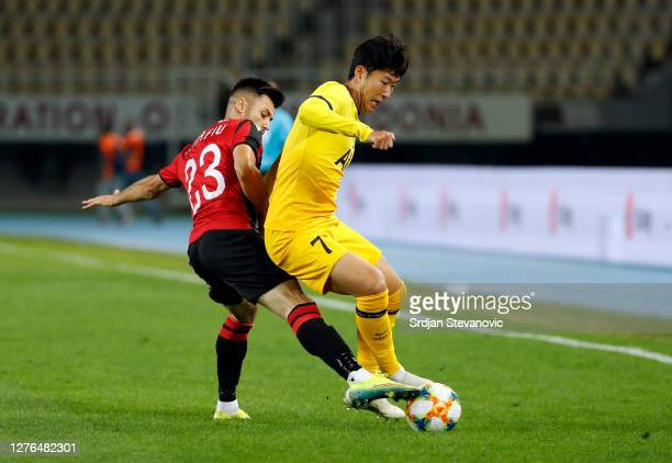 Valmir Nafiu of KF Shkendija battles for possession with Son HeungMin of Tottenham Hotspur during the UEFA Europa League third round qualifying match...