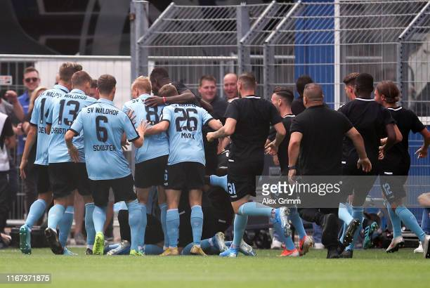 Valmir Sulejmani of Mannheim celebrates his team's first goal with team mates during the DFB Cup first round match between SV Waldhof Mannheim and...