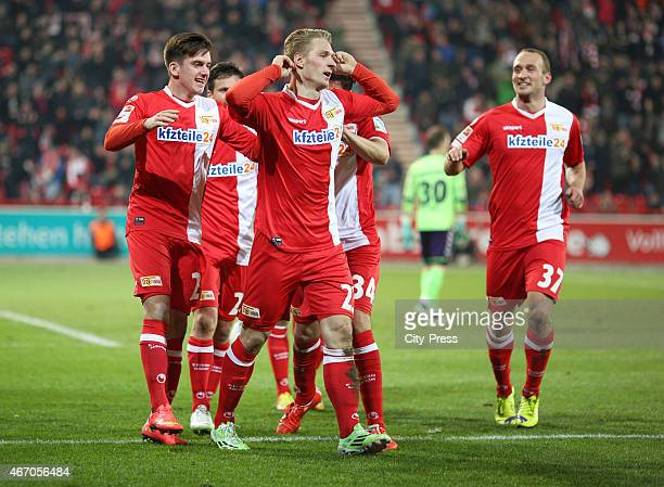 Valmir Sulejmani,Sebastian Polter and Toni Leistner of 1 FC Union Berlin celebrate after scoring the 1:0 during the match between Union Berlin and FC...