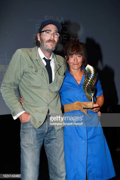 Valois Canal du public for L'Amour flou Philippe Rebbot and Romane Bohringer attend the Closing Ceremony of the 11th Angouleme FrenchSpeaking Film...