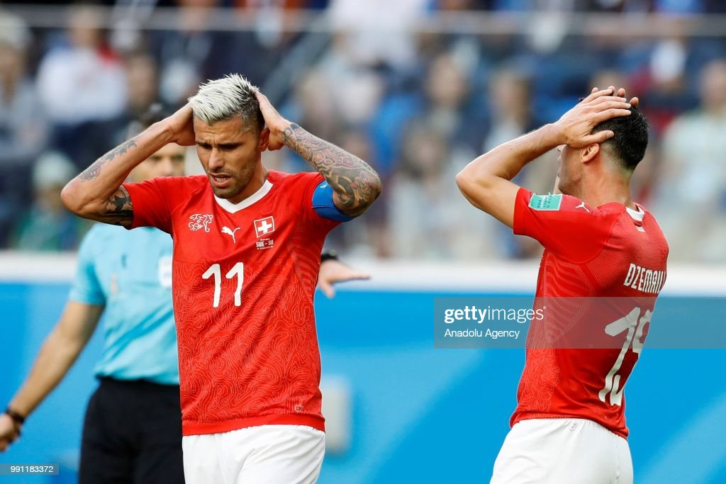 Valon Behrami (L) and Blerim Dzemaili of Switzerland gesture during of the 2018 FIFA World Cup Russia Round of 16 match between Sweden and Switzerland at the Saint Petersburg Stadium in Saint Petersburg, Russia on July 03, 2018.