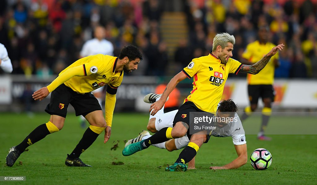 Valon Behrami (r) challenges Fernando Llorente (r) during the Premier League match between Swansea City and Watford at Liberty Stadium on October 22, 2016 in Swansea, Wales.