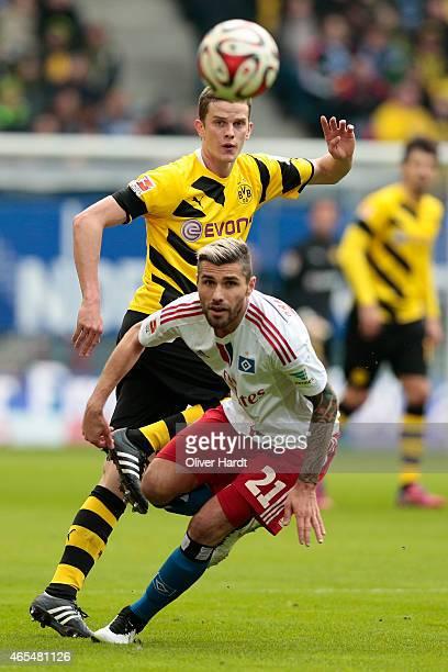 Valon Behrami of Hamburg and Sven Bender of Dortmund compete during the First Bundesliga match between Hamburger SV and Borussia Dortmund at Imtech...