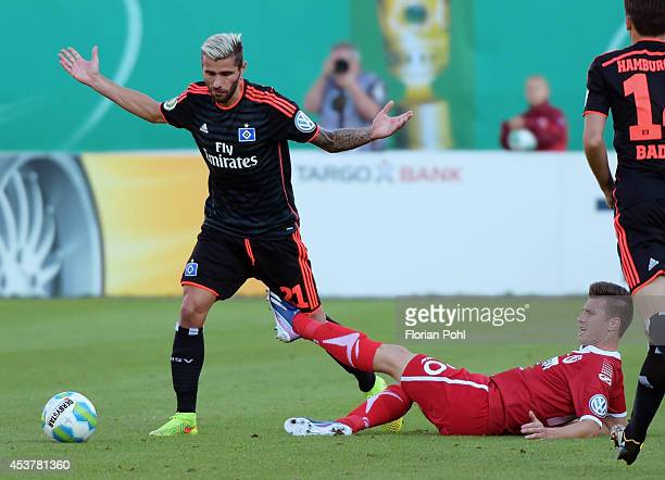 Valon Behrami of Hamburger SV is challenged by Rok Elsner of FC Energie Cottbus during the DFP Cup first round match between Energie Cottbus and...
