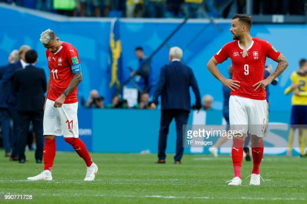 Valon Behrami of Switzerland and Haris Seferovic of Switzerland look dejected after the 2018 FIFA World Cup Russia Round of 16 match between Sweden...