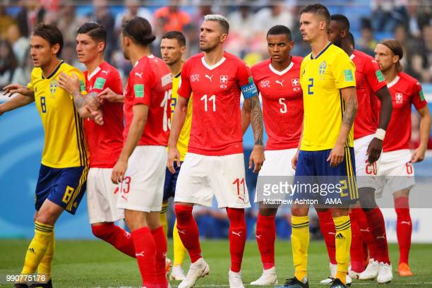 Valon Behrami of Switzerland and Manuel Akanji of Switzerland look on during the 2018 FIFA World Cup Russia Round of 16 match between Sweden and...