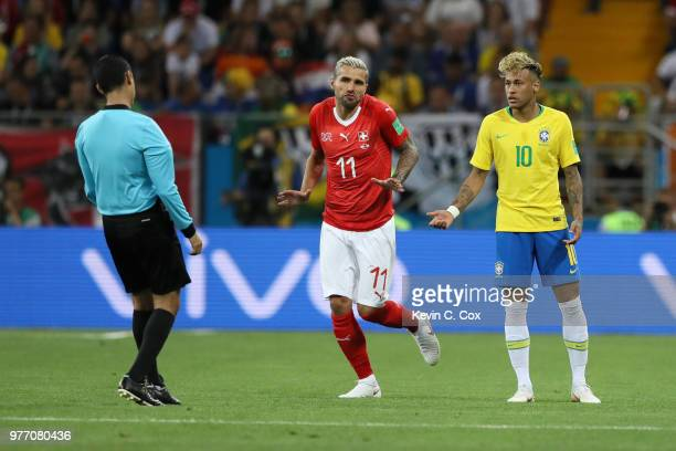 Valon Behrami of Switzerland and Neymar Jr of Brazil both react to a decision by referee Cesar Ramos during the 2018 FIFA World Cup Russia group E...