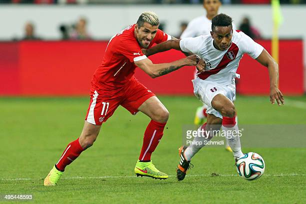 Valon Behrami of Switzerland fights for the ball with Andre Carrillo of Peru during the international friendly match between Switzerland and Peru at...