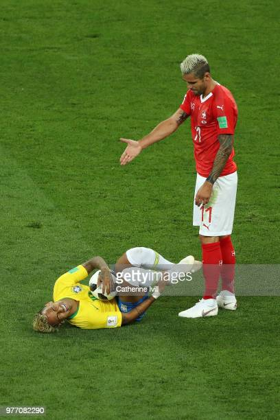 Valon Behrami of Switzerland gestures as Neymar Jr of Brazil rolls on the floor during the 2018 FIFA World Cup Russia group E match between Brazil...