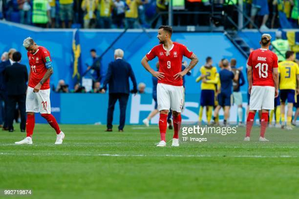 Valon Behrami of Switzerland Haris Seferovic of Switzerland and Josip Drmic of Switzerland look dejected after the 2018 FIFA World Cup Russia Round...