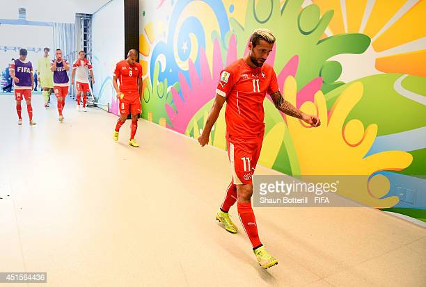 Valon Behrami of Switzerland shows his dejection in the tunnel after the 01 defeat in the 2014 FIFA World Cup Brazil Round of 16 match between...