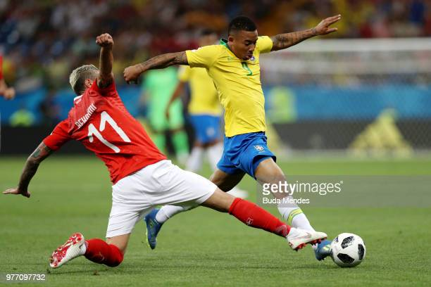 Valon Behrami of Switzerland tackles Gabriel Jesus of Brazil during the 2018 FIFA World Cup Russia group E match between Brazil and Switzerland at...
