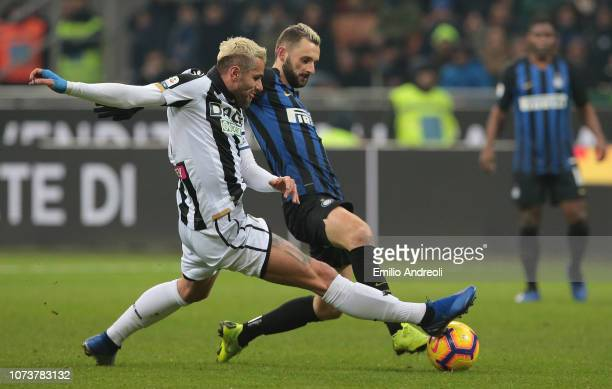 Valon Behrami of Udinese Calcio is challenged by Marcelo Brozovic of FC Internazionale during the Serie A match between FC Internazionale and Udinese...