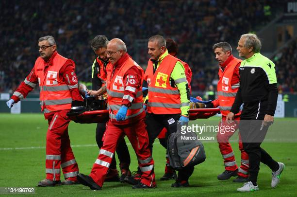 Valon Behrami of Udinese leaves the pitch on a stretcher during the Serie A match between AC Milan and Udinese at Stadio Giuseppe Meazza on April 2...