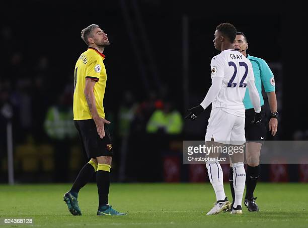 Valon Behrami of Watford and Demarai Gray of Leicester City exchange words during the Premier League match between Watford and Leicester City at...