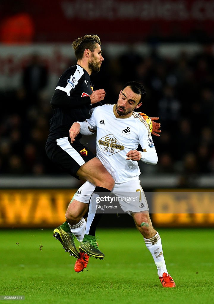 Valon Behrami of Watford jumps for the ball with Leon Britton of Swansea City during the Barclays Premier League match between Swansea City and Watford at Liberty Stadium on January 18, 2016 in Swansea, Wales.