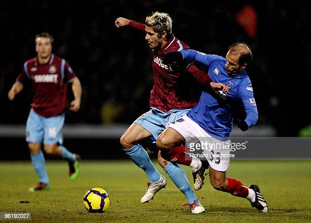 Valon Behrami of West Ham holds off Angelos Basinas of Pomey during the Barclays Premier League match between Portsmouth and West Ham United at...