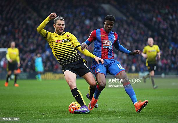 Valon Berami of Watford and Wilfried Zaha of Crystal Palace compete for the ball during the Barclays Premier League match between Crystal Palace and...