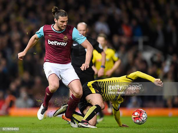 Valon Berami of Watford goes down under aq challenge from Andy Carroll of West Ham United during the Barclays Premier League match between West Ham...