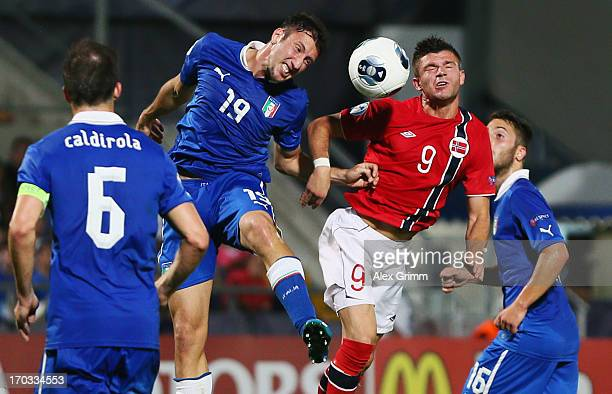 Valon Berisha of Norway is challenged by Luca Caldirola Vasco Regini and Andrea Bertolacci of Italy during the UEFA European U21 Championship Group A...