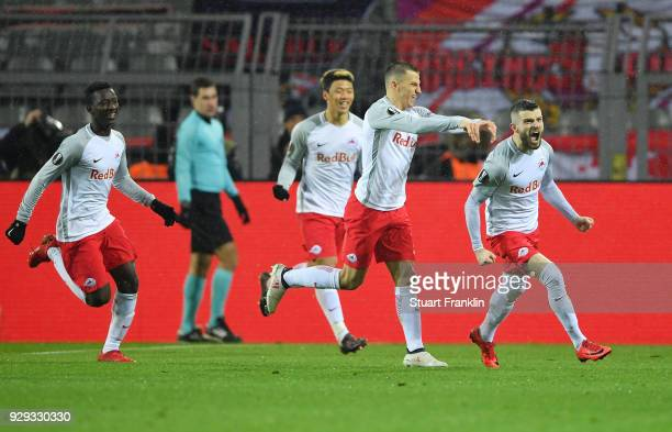 Valon Berisha of Red Bull Salzburg celebrates as he scores their first goal from the penalty spot during the UEFA Europa League Round of 16 match...