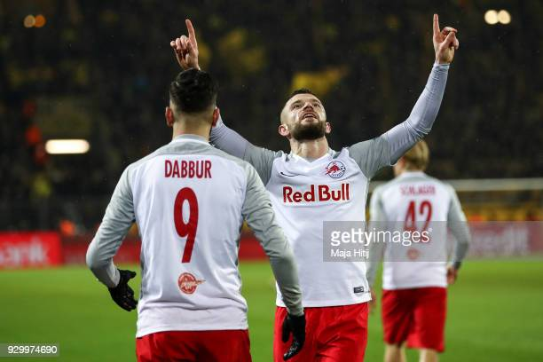 Valon Berisha of Red Bull Salzburg celebrates with Munas Dabbur as he scores second goal during the UEFA Europa League Round of 16 match between...