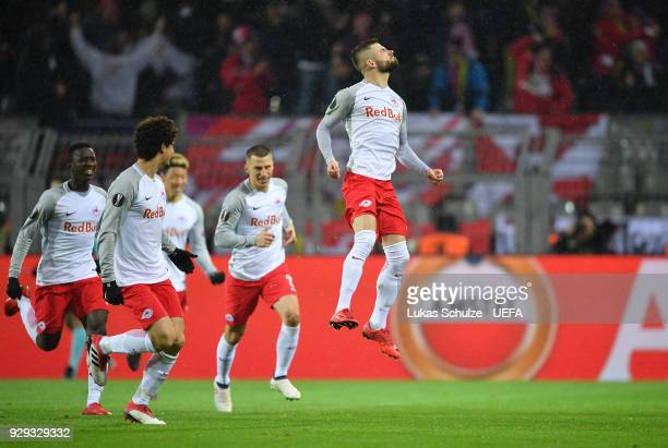 Valon Berisha of Red Bull Salzburg celebrates with team mates as he scores their first goal from the penalty spot during the UEFA Europa League Round...