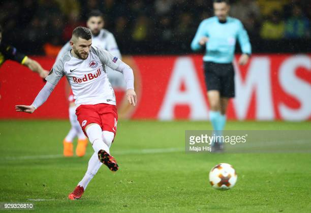 Valon Berisha of Red Bull Salzburg scores their first goal from the penalty spot during the UEFA Europa League Round of 16 match between Borussia...