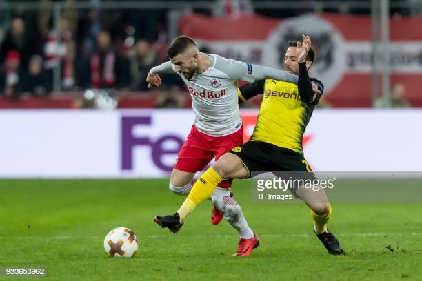 Valon Berisha of Salzburg and Gonzalo Castro of Dortmund battle for the ball during UEFA Europa League Round of 16 second leg match between FC Red...
