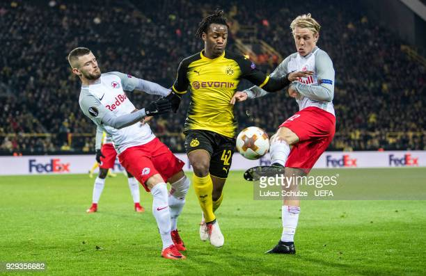 Valon Berisha of Salzburg Michy Batshuayi of Dortmund and Xaver Schlager of Salzburg fight for the ball during UEFA Europa League Round of 16 match...