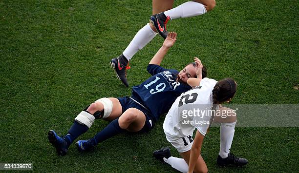 Valor Christian Eagles mf forw Brianna Johnson hits the ground as she gets caught between LewisPalmer Rangers mf Kate Devine and LewisPalmer Rangers...