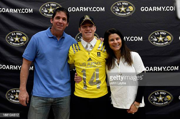 Valor Christian High School football player standout Christian McCaffrey stands with his dad Ed McCaffrey and mom Lisa McCaffrey during his US...