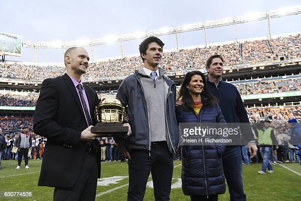 Valor Christian quarterback Dylan McCaffrey accepts the Gold Helmet award from Denver Post reporter Kyle Newman during halftime between the Denver...