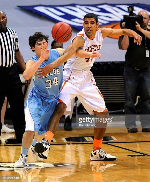 Valor senior Max McCaffrey battled for a rebound with Lewis Palmer center Josh Scott in the first half The Lewis Palmer High School boy's basketball...