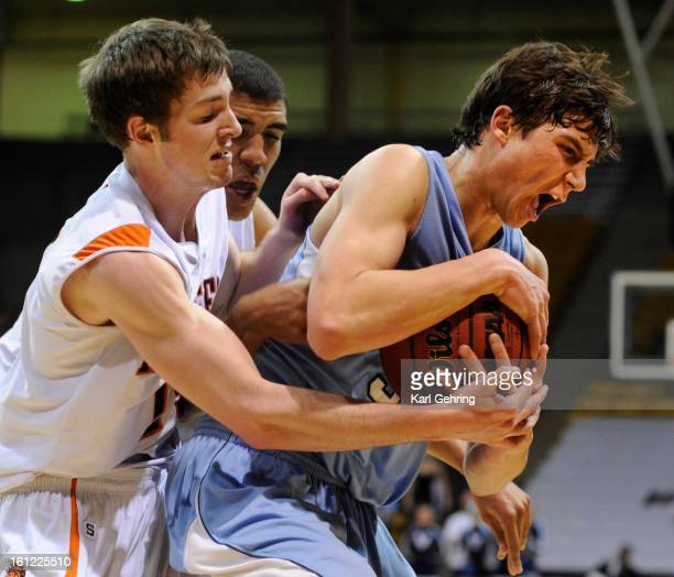 Valor senior Max McCaffrey right controlled a rebound in the second half The LewisPalmer High School boy's basketball team defeated Valor Christian...